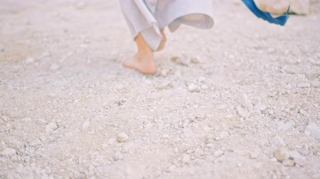 insult : A young woman barefoot is on a dirt road. Stock Footage