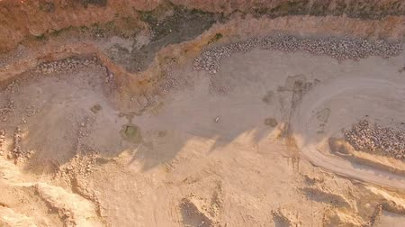 surrealismo : Surreal picture. Young bosy1 man plays the piano in an abandoned territory sandy quarry. Aerial view. Stock Footage