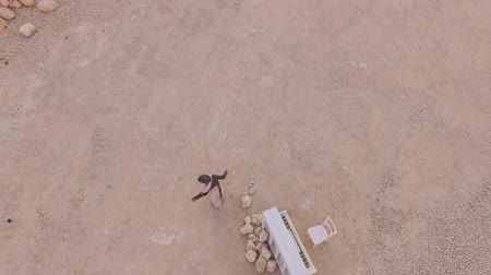enchanted princess : Surreal story- girl near the white piano in the desert against the background of mountains . Aerial view. View from above