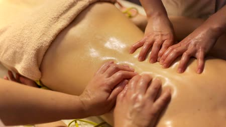 revitalizing : Ayurvedic back massage in four hands. close-up. Stock Footage