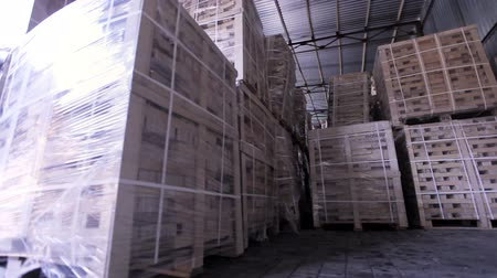 forklift : Production of plywood in a furniture factory. Storage room with packed plywood