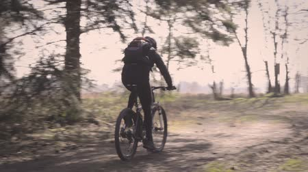sporty zimowe : winter biking - biker riding on a sunny winter day