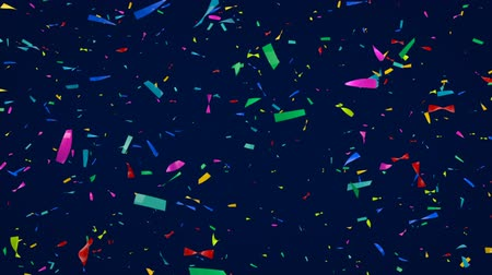 Поздравляю : Colorful confetti - Slowly spinning 3D confetti moving towards the camera - slow motion Стоковые видеозаписи