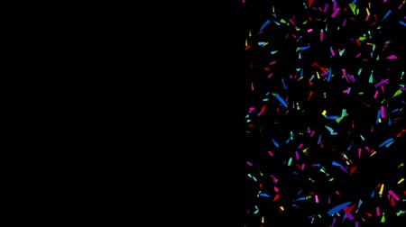 zaproszenie : Colorful confetti in front of a black background - Slow Motion