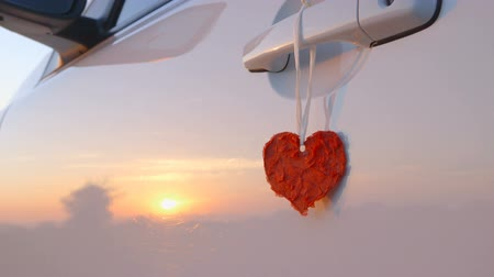 hediyeler : Beautiful Red Heart Hanging on a Door Handle of a Car - camera pan Stok Video