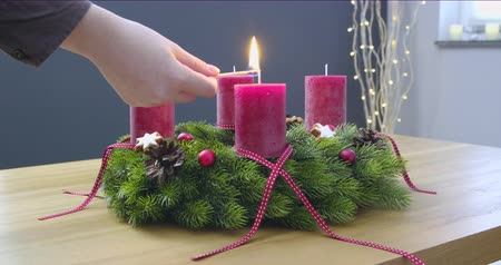 gelişi : First Sunday of Advent - a young woman is lighting the first candle of the advent wreath - ProRes Stok Video