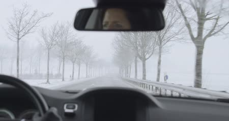 Winter Driving - driving on a country road at heavy snowfall Vídeos