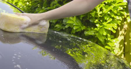 driveway : Washing a Car by Hand - camera pan - ProRes