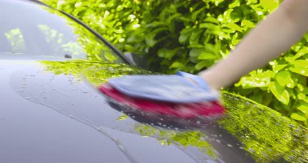 cricket : Washing a Car by Hand - camera pan - ProRes