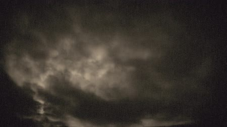 tek renkli : Eerie fast moving clouds, backlit by the low full moon - old film look or old projector look - ProRes