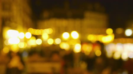 Christmas Market Impressions - Defocused shot of a beautiful Christmas market by night Vídeos