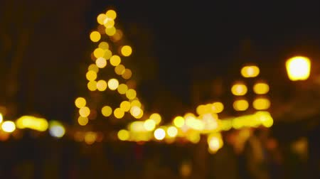 christmas tree decoration : Christmas Market Impressions - Defocused shot of a beautiful Christmas market by night Stock Footage