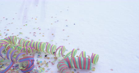 Party in the snow - streamers and a shower of confetti - celebration concept - ProRes