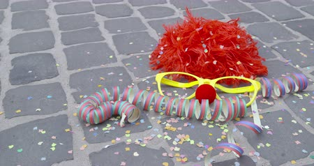 setts : A funny wig, disguise glasses, a nose of foam material, streamers and a shower of confetti - carnival concept or celebration concept - ProRes
