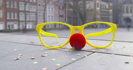 jubileu : Carnival - disguise glasses, a red nose and a shower of confetti - carnival concept or celebration concept - ProRes Stock Footage
