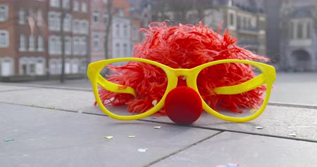 jubileu : Carnival - a funny wig, disguise glasses, a red disguise nose and confetti - carnival concept or celebration concept - ProRes