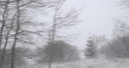 Bad Weather Winter Driving - Driving on a country road - This is leading up a plateau region - View from the side window - Hand held camera - ProRes Stock mozgókép
