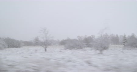 plateau : Bad Weather Winter Driving - Driving on a country road - This is leading up a plateau region - View from the side window - Hand held camera - ProRes Stock Footage