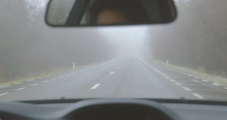 Driving on a mountain road on a foggy winter day - POV shot - hand held camera - ProRes