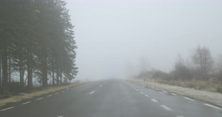 Driving on a country road on a foggy winter day - POV shot - hand held camera - ProRes Stock mozgókép