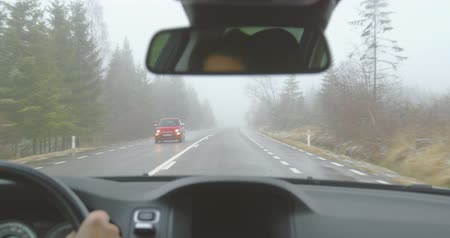 Oncoming traffic - driving on a mountain road on a foggy winter day - POV shot - hand held camera - ProRes Stock mozgókép