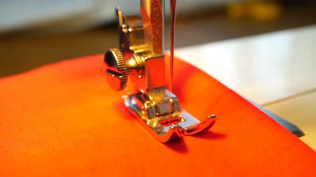 clothing : video of woman sews on the sewing machine Stock Footage