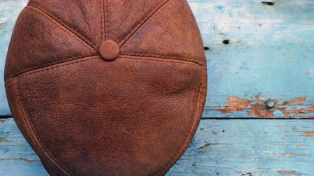 western wear : leather headgear - hat hanging on a wooden wall. Stock Footage