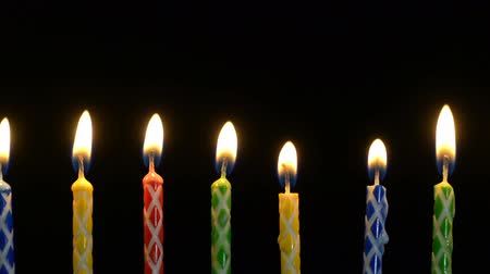doğum günü : Footage colorful burning candles set on black background