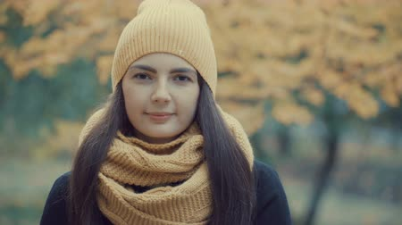 başörtüsü : portrait of a beautiful girl in a park in autumn.