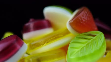 sakızlı : Footage of bright tasty colourful marmalade jelly candies rotate