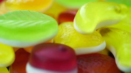 solucan : Footage of bright tasty colourful marmalade jelly candies rotate. Stok Video