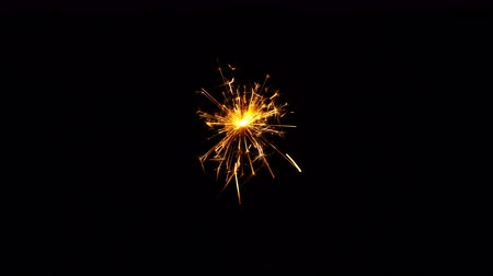 luminosidade : Sparkler isolated on black background