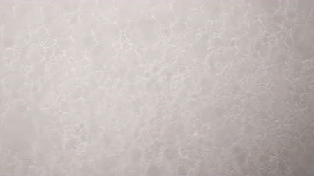 suds : Footage white foam with bubbles rotate close up