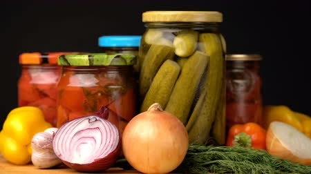 консервированный : Footage glass jars with salted vegetables for the winter rotated on table.