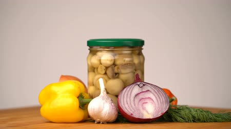 cuketa : Footage glass jars with salted vegetables for the winter rotated on table.
