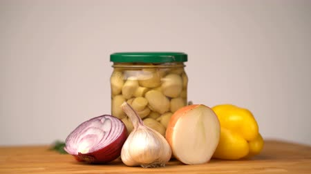 konzervipar : Footage glass jars with salted vegetables for the winter rotated on table.