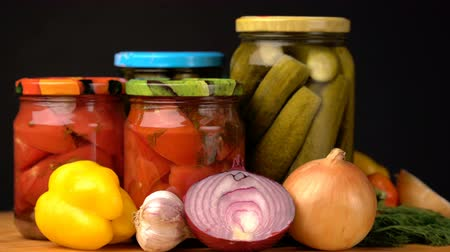 pickled : Footage glass jars with salted vegetables for the winter rotated on table.