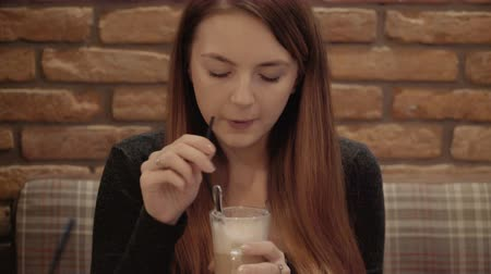 girl drinks coffee in a restaurant.
