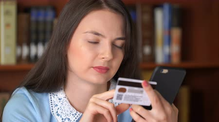 pretty woman shopping online with easy pay using smartphone and credit card Stock Footage