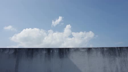 locomotion : Time-lapse footage of the cloud moving over the wall with the shadow fading Stock Footage