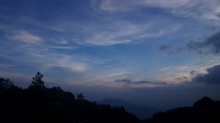 locomotion : Time-lapse footage of cloud over the forest in the evening and become dark , Chiang Mai, Thailand
