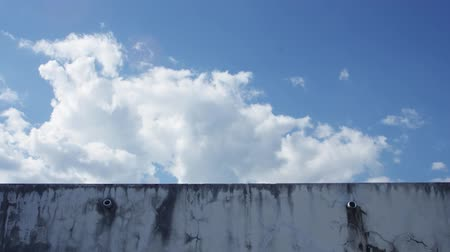 locomotion : Time-lapse footage of the cloud moving over the wall