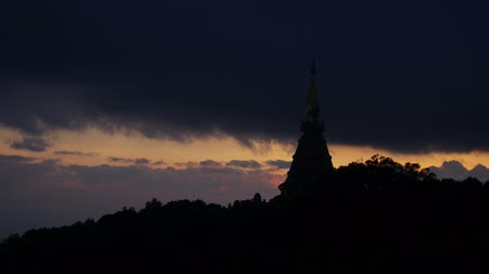 locomotion : Time-lapse footage of the cloud movement over the pagoda on mountain range in the evening Stock Footage