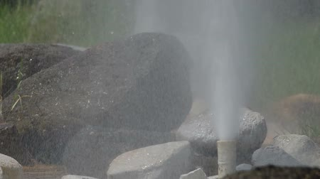 locomotion : two geysers surround with rocks, Geyser from Sun Kam Pang Hotspring, Chiang Mai, Thailand Stock Footage