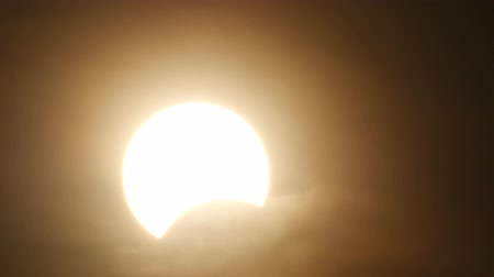 napos : the nearly ending part of partly solar eclipse when sun rise in Thailand