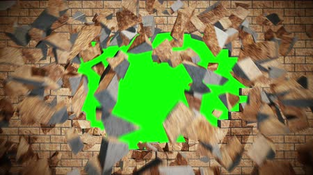 explodir : Camera flying through a crashing red brick wall revealing green screen chroma key background behind