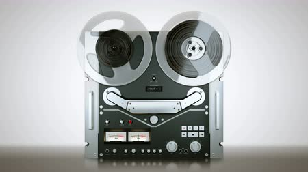 шестидесятые годы : Old reel tape recorder with spinning reels. Front view. Chroma key Green screen. 4K. Стоковые видеозаписи