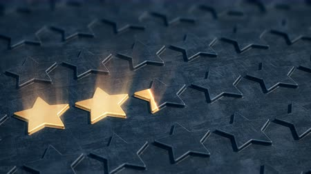 excelência : Five golden stars appear on the black relief surface. The concept of company reputation and business excellence. Stock Footage