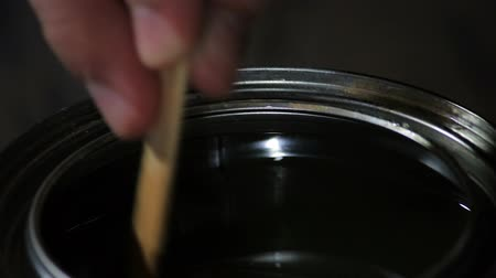 remodelar : stir stick driping stain into tin can