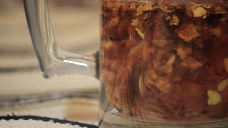 hot water pouring over tea leaves